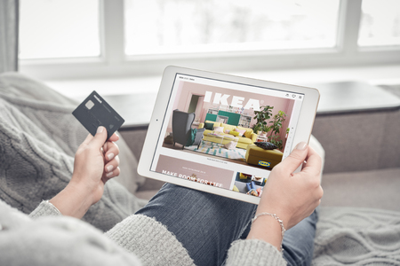 Kiev, Ukrain - February 10, 2018: Woman using IKEA app on a brand new Apple iPad Pro Silver to order furniture. IKEA was founded in of Sweden in 1943, IKEA to have large chain stores around the world. Redactioneel