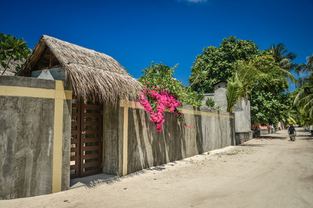 Empty street in traditional Maldivian village on Fehendhoo island, Baa atoll