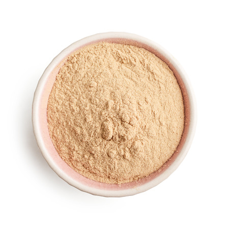 Bowl of baobab powder isolated on white background, top view