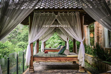 Canopies for massage in resort on Bali island at rainy day Stock Photo - 111494488