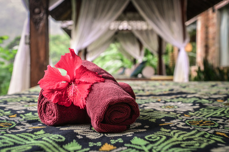 Canopies for massage with towels in resort on Bali island closeup Stock Photo - 111494677