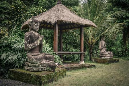 Stone Buddha statue  in garden on Bali island, Indonesia Stock Photo