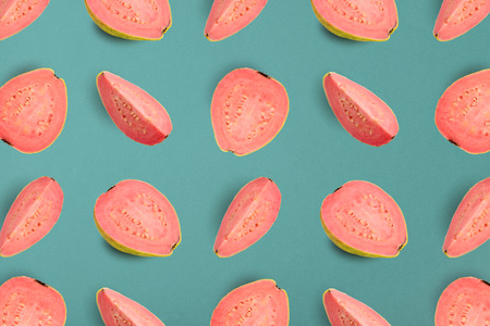 Colorful fruit pattern of guava on blue background, top view