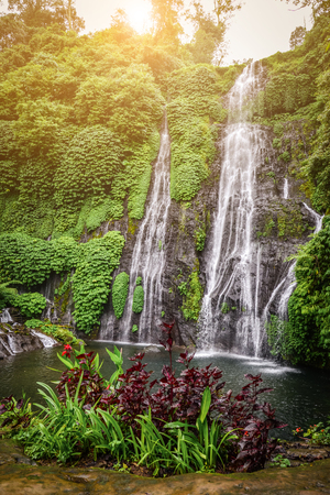 Jungle waterfall cascade in tropical rainforest with rock and turquoise blue pond. Banyumala twin waterfall in Bali, Indonesia. Stock fotó