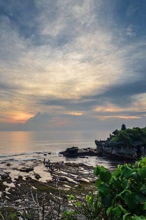 Coastline near the Tanah Lot Temple, the most important indu temple of Bali, Indonesia at sunset