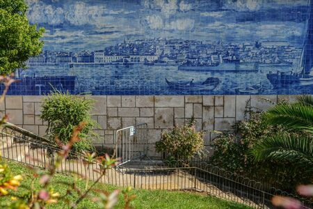 Traditional tile azulejos on the facade of the building in the  Alfama district in Lisbon, Portugal Stock Photo
