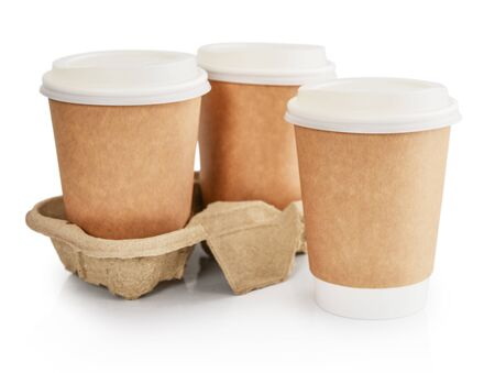 Blank disposable takeaway coffee cups in holder isolated on white background including clipping path
