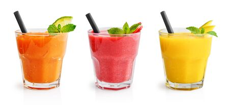 Glasses of papaya, mango and strawberry smoothie isolated on white background. Clipping path included