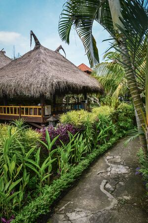 Traditional gazebo with straw roof in Balinese style in beautyfull garden