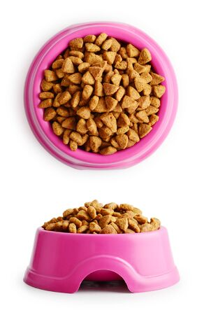 Dry cat food in pink bowl isolated on white Фото со стока