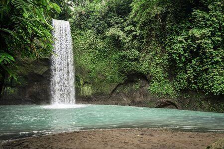 The beautiful  Tibumana Waterfall (air terjun Tebumana) near Ubud, Bali, Indonesia