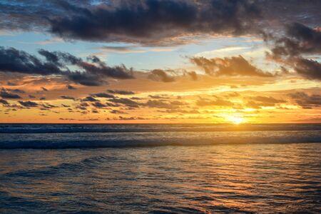 Beautiful bright purple sunset on the ocean on Bali island 写真素材