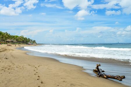 Petitenget Beach in Seminyak  at sunny day, popular Sunset Beach in Bali, Indonesia