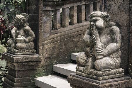 Traditional Balinese stone sculpture for outdoore decoration of houses and  temples at Bali, Indonesia 版權商用圖片