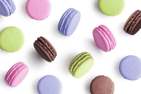 Colorful cake macaron or macaroon on white background as pattern. Top view.
