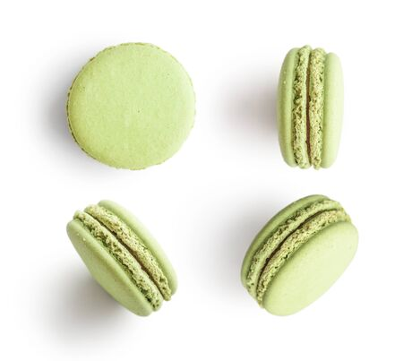 Set of green french macarons isolated on white background. Top view. 版權商用圖片