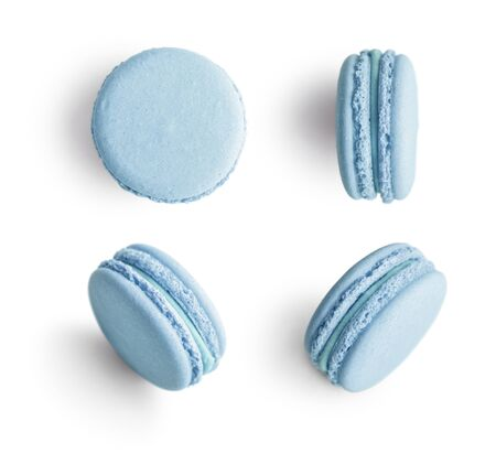 Set of blue french macarons isolated on white background. Top view.
