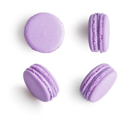 Set of violet french macarons isolated on white background. Top view. 版權商用圖片