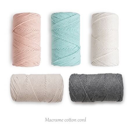 Macrame cotton cord spools in different pastel colors isolated on white, top view
