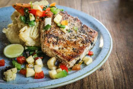 Grilled Tuna Steak served with mashed potato, sauted veggies & fresh pineapple salsa