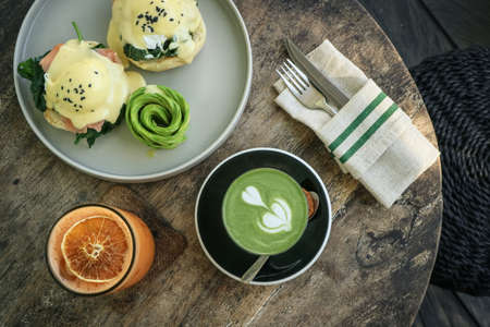 Avocado toast with poached egg, matcha latte and orange juice for breackfast, top view Foto de archivo - 154473992