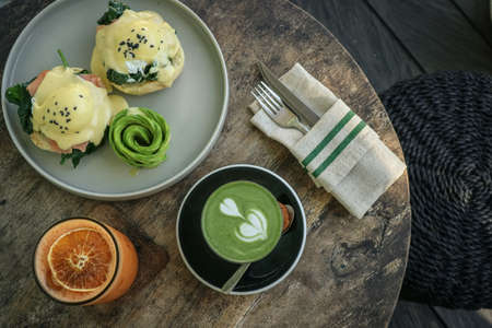 Avocado toast with poached egg, matcha latte and orange juice for breackfast, top view Foto de archivo - 154474022