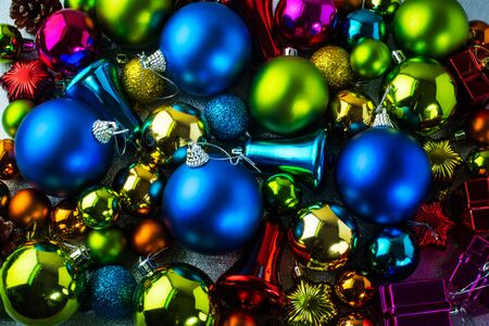 jingle bells: Christmas colorful decoration of blue, red, purple, yellow, gold, green balls, jingle bells background