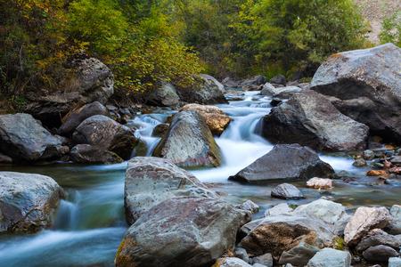 fluvial: Stony bottom of the mountain river. Cascade waterfalls. Altai Mountains, Russia Stock Photo