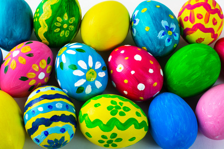 Easter background of hand-painted multicolored Easter eggs. Easter symbol. Top view with copy space