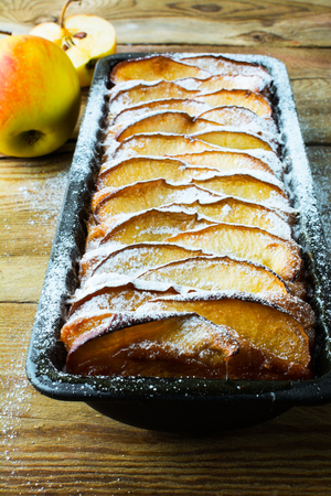 caster: Apple tart with fresh fruits and caster sugar. Puff pastry fruit dessert pie, selective focus Stock Photo