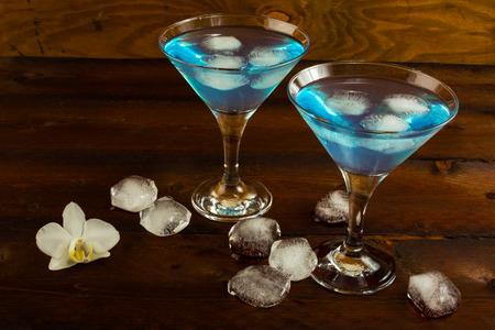 blue lagoon: Blue cocktail in a martini glasses. Blue cocktail. Blue Martini. Blue Hawaiian cocktail. Blue curacao liqueur.  Blue margarita