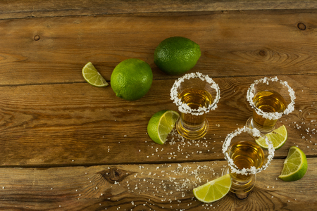 tequila: Gold Mexican tequila with lime and salt. Tequila. Tequila shot