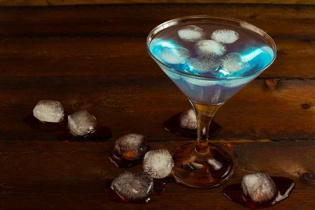 blue hawaiian drink: Martini glass of Blue cocktail. Blue cocktail. Blue Martini. Blue Hawaiian cocktail. Blue curacao liqueur.  Blue margarita