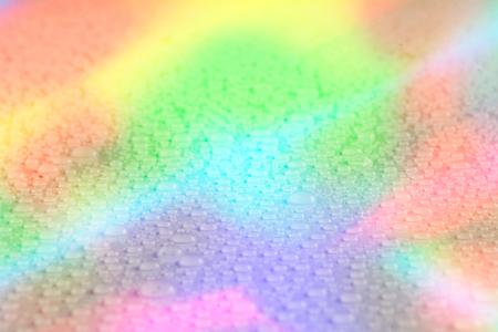 drop water: Rainbow water drop texture. Water drop background. Rainbow background
