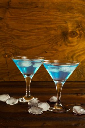 blue hawaiian drink: Blue Curacao liqueur cocktail in a martini glasses. Blue cocktail. Blue margarita. Blue Hawaiian cocktail. Blue curacao liqueur.  Blue Martini