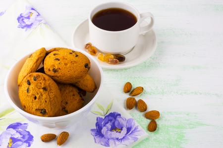 almond biscuit: Sweet cookies,  tea cup and almond. Sweet dessert. Homemade biscuit. Breakfast cookies. Tea cup. Tea time. Homemade cookies. Stock Photo