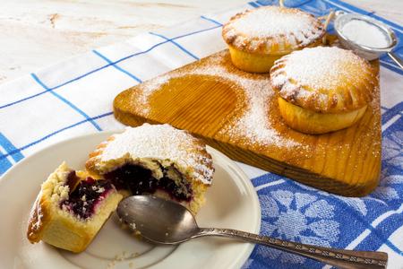 jam tarts: Sweet dessert on the white plate. Sweet dessert. Sweet pastry. Small pie. Pie. Jam pie Stock Photo