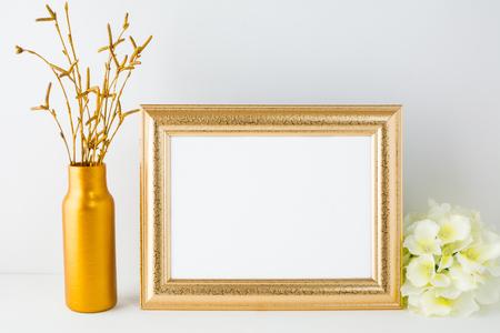 Landscape gold frame mockup. Landscape mockup. Frame mockup. Poster Mockup. Styled mockup. Product mockup.  Design Mockup. Gold frame mockup. White frame mockup. 版權商用圖片 - 57964341