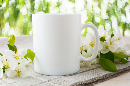 Mug mockup with apple blossom. Mug mockup. Coffee cup template. Coffee mug template. Mug template. Mug design template. Mug design. Mug printing design. White mug mockup. Cup mockup. Blank mug.