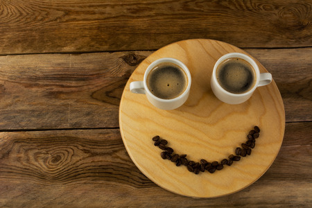 Funny coffee break concept on wooden background. Coffee cup. Coffee mug. Morning coffee. Cup of coffee. Coffee break. Strong coffee. 版權商用圖片