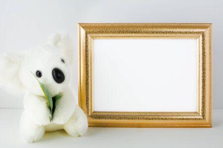 animals frame: Nursery mockup with white bear. Frame mockup. Poster Mockup. Nursery mockup. Styled mockup. Product mockup. Design Mockup. White frame mockup. Gold frame mockup. Landscape mockup Stock Photo