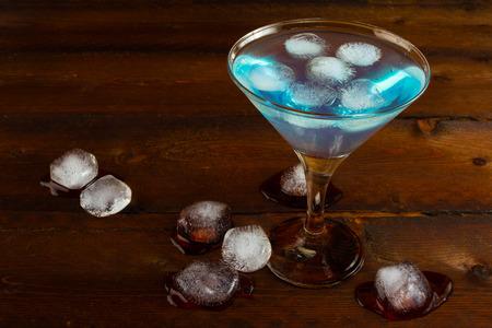 blue hawaiian drink: Iced blue margarita cocktail. Blue margarita. Blue cosmopolitan. Blue Lagoon. Blue cocktail. Blue Martini. Blue Hawaiian cocktail. Blue curacao liqueur.