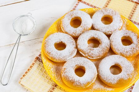 caster: Homemade sweet donuts with caster sugar. Hanukkah homemade donuts. Sweet dessert. Sweet pastry doughnuts.