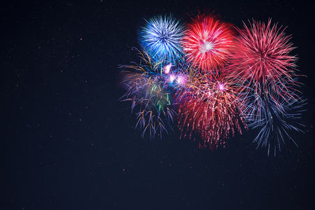 july 4th: Beautiful celebration fireworks over starry sky, copy space.  Independence Day, New Year holidays salute. 4th of July beautiful fireworks. Holidays background. Stock Photo