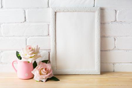 White frame mockup with white and golden vases. Empty white frame mockup for design presentation. Portrait or poster white frame mockup.