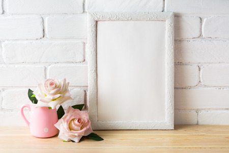 White frame mockup with white and golden vases. Empty white frame mockup for design presentation. Portrait or poster white frame mockup.