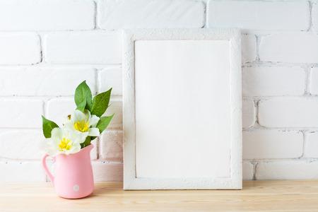 White frame mockup with rustic pink flower pot. Portrait or poster white frame mockup. Empty white frame mockup for presentation artwork design.