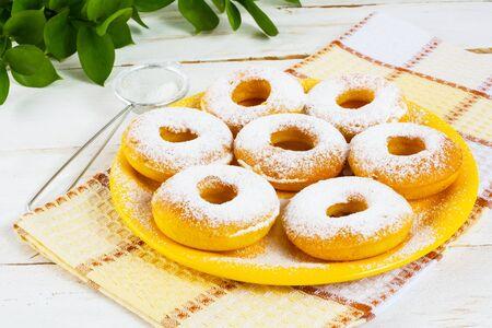 caster: Homemade Hanukkah donuts with caster sugar. Hanukkah sweet donuts. Sweet dessert pastry doughnuts.