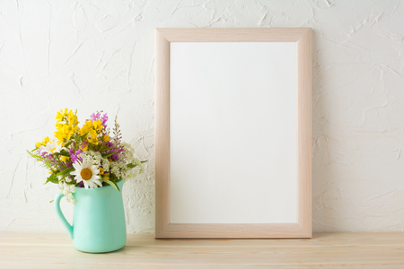 Frame mockup with tender flowers in mint green vase. Poster white frame mockup. Empty white frame mockup for presentation design. 版權商用圖片 - 60110181