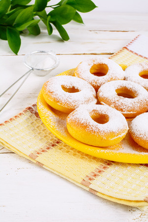 caster: Sweet donuts with caster sugar. Hanukkah homemade donuts. Sweet dessert. Sweet pastry doughnuts.